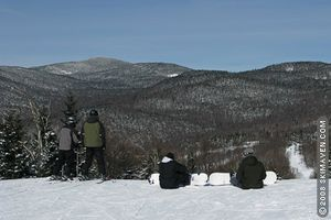 College-aged skiers and riders take to the mountains of northern Vermont