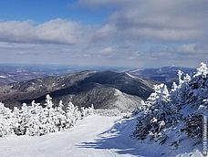 Photo of snowy mountains from atop Sugarbush, Vermont