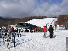 Photo of people in snowy base area in Stowe, Vermont