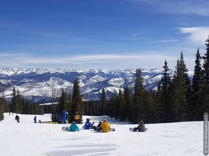 Ski and snowboard lessons with a view of the Rocky Mountains