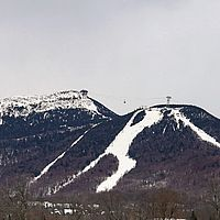 Photo of Jay Peak Resort from a distance showing the tram