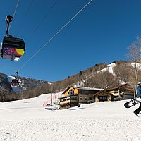 Photo of gondola ascending a ski area