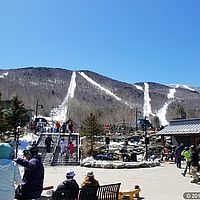 Photo of base area of Sugarbush Resort with ski runs in the background