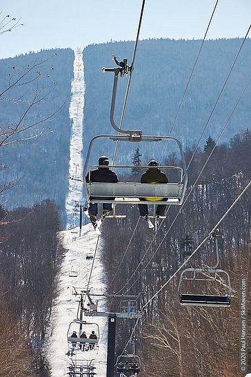Photo of people riding on the 2-mile-long Slide Brook Express chairlift