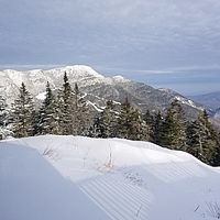 Photo of the summit of Mt. Mansfield and trails below it