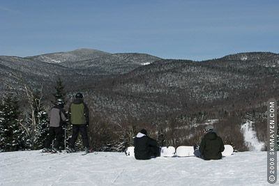College-aged skiers and riders take to the mountains of northern Vermont.
